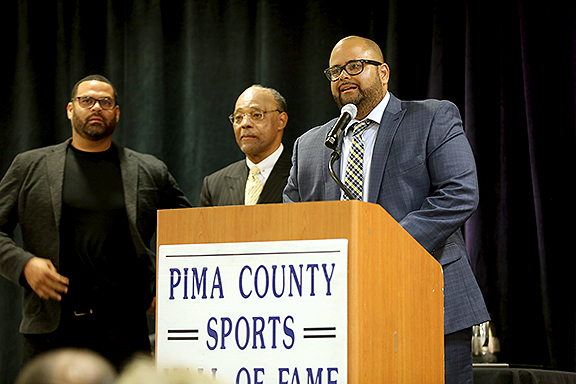 Delano Price flanked by Albert Sye's sons Pima County Sports Hall of Fame
